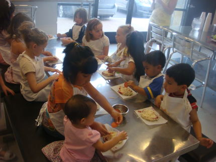 Kids making pizza at Little Pastry Chefs