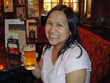 Jen drinking a baby beer at the pub
